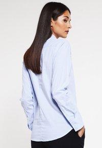 Filippa K - CLASSIC - Button-down blouse - light blue stripe - 2