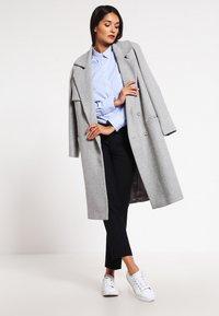 Filippa K - CLASSIC - Button-down blouse - light blue stripe - 1