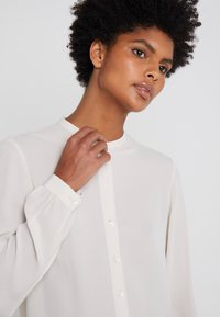 Filippa K - ADELE BLOUSE - Button-down blouse - ivory - 4