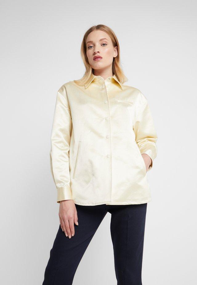 TANYA - Button-down blouse - ecru