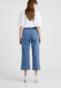 Filippa K - LAURIE WASHED - Flared jeans - mid blue - 2