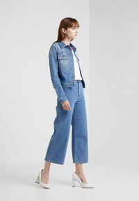 Filippa K - LAURIE WASHED - Flared jeans - mid blue - 1