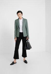 Filippa K - HALLY  - Bootcut jeans - black - 1