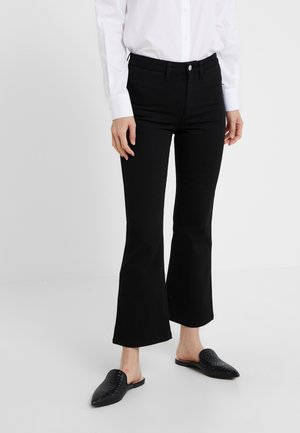 HALLY  - Bootcut jeans - black