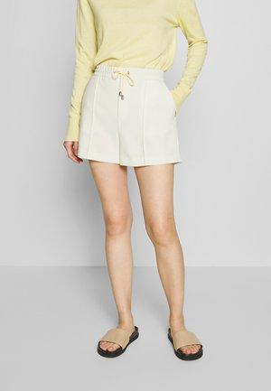 KELLY - Shorts - faded yellow