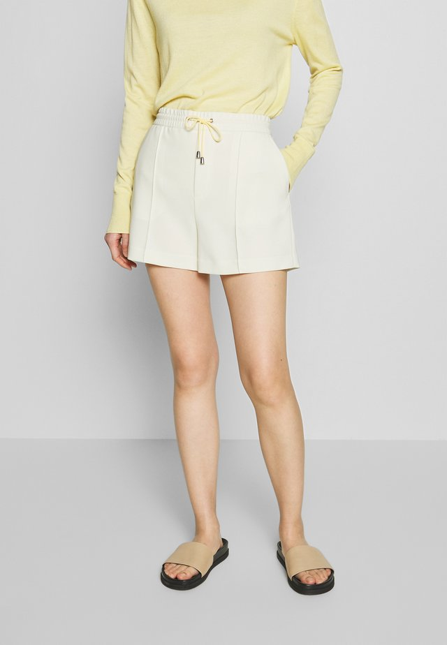 KELLY - Shorts - faded yellow