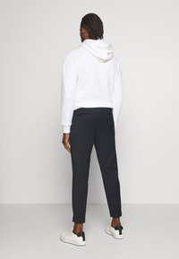 Filippa K - TERRY CROPPED PANTS - Trousers - navy - 2