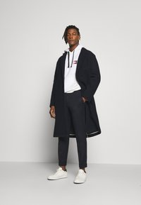 Filippa K - TERRY CROPPED PANTS - Trousers - navy - 1