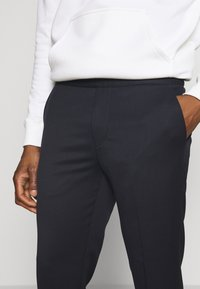 Filippa K - TERRY CROPPED PANTS - Trousers - navy - 4