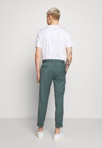 Filippa K - TERRY CROPPED PANTS - Trousers - dark mint powder