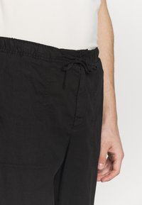 Filippa K - THEODORE TROUSER - Spodnie materiałowe - black - 3