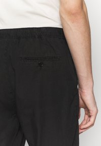 Filippa K - THEODORE TROUSER - Spodnie materiałowe - black - 5