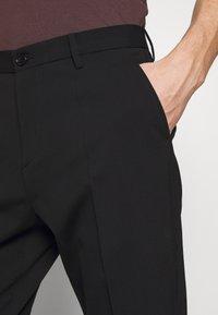 Filippa K - WILLIAM TROUSER - Trousers - black - 3