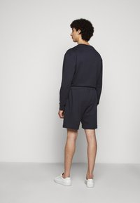 Filippa K - FELIX  - Tracksuit bottoms - ink blue - 2