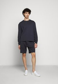 Filippa K - FELIX  - Tracksuit bottoms - ink blue