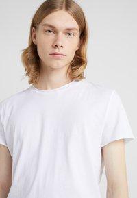 Filippa K - ROLL NECK TEE - T-shirt basique - white - 4
