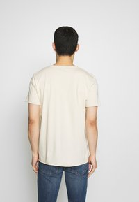 Filippa K - ROLLNECK - T-shirt basic - almond white - 2
