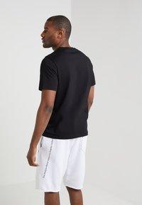 Filippa K - SINGLE CLASSIC TEE - T-shirt - bas - black - 2