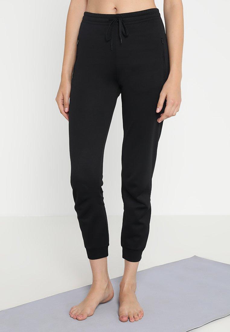 Filippa K - SHINY TRACK PANTS - Teplákové kalhoty - black