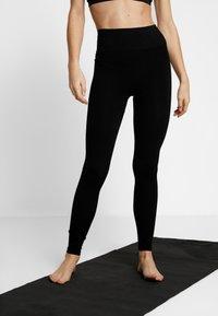 Filippa K - SEAMLESS COMPRESSION LEGGINGS - Legging - black - 0