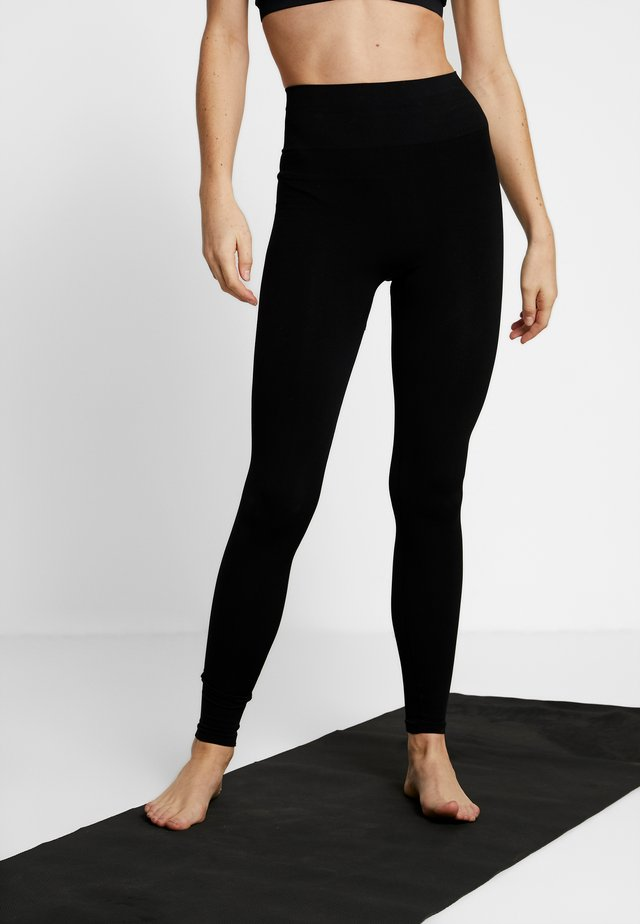 SEAMLESS COMPRESSION LEGGINGS - Punčochy - black