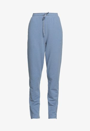 AMERICAN JOGGER - Tracksuit bottoms - misty blue