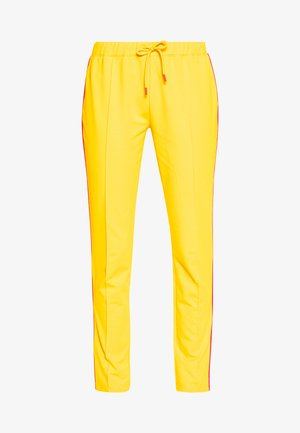 THEA - Tracksuit bottoms - yellow