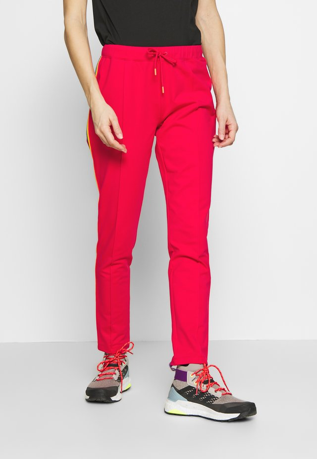 THEA - Tracksuit bottoms - pink