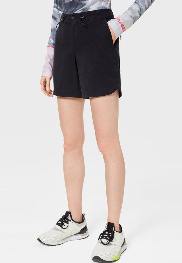 EMILIE - Sports shorts - black
