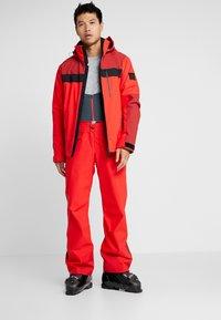 Bogner Fire + Ice - DAMIAN - Snowboardová bunda - orange/red - 1