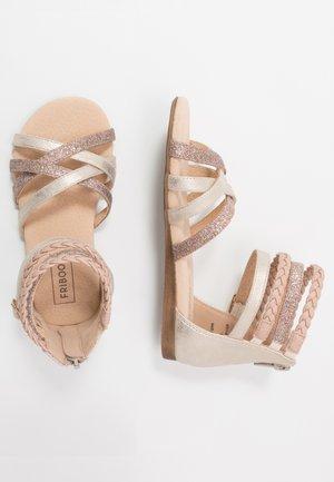 Sandaalit nilkkaremmillä - champagne