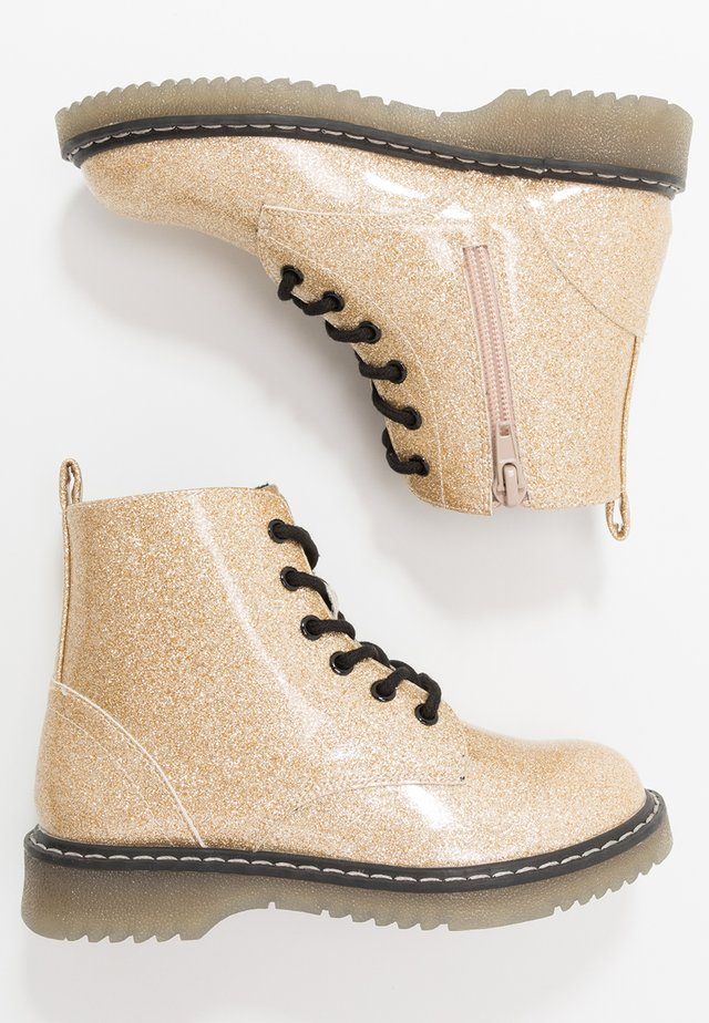 Lace-up ankle boots - gold