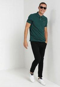Farah - DRAKE - Spodnie materiałowe - black - 1