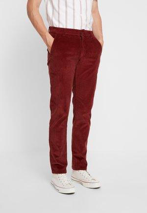 Tygbyxor - burnt red