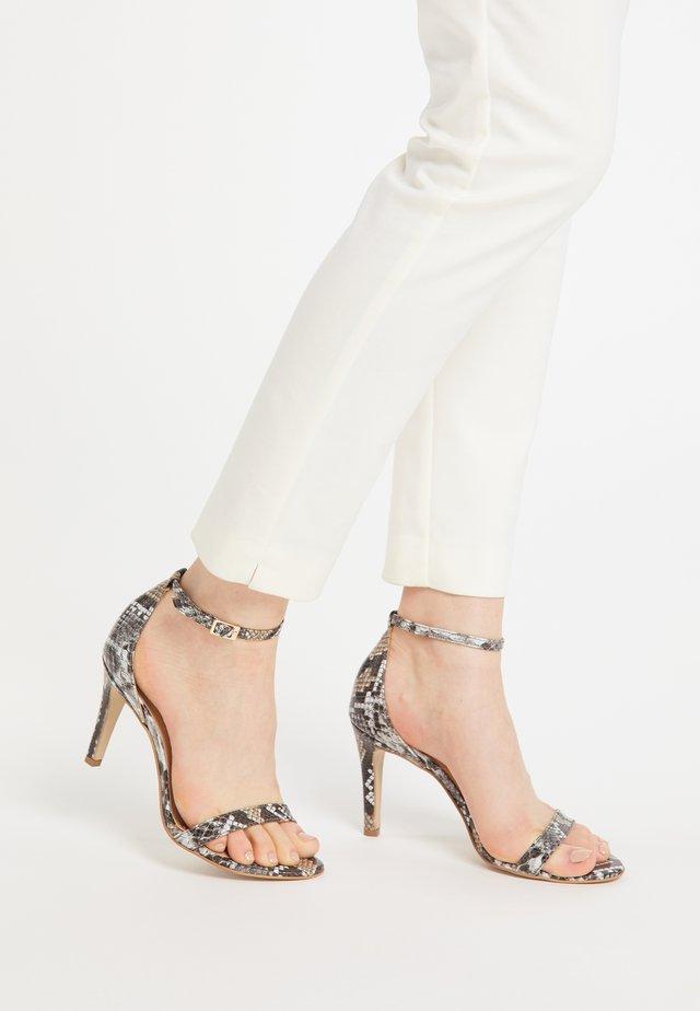 High heeled sandals - schlange