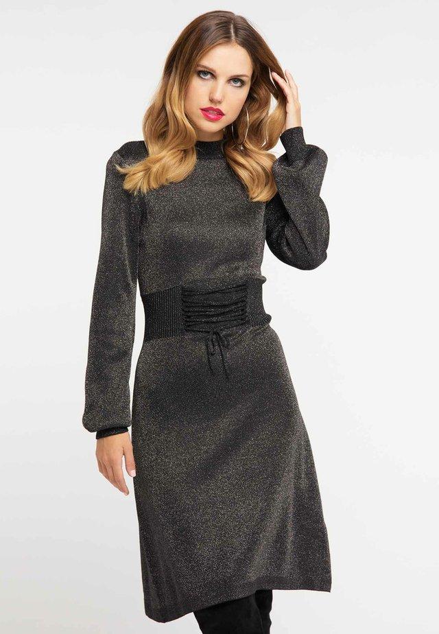 Stickad klänning - black