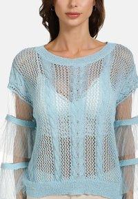 faina - Stickad tröja - light blue - 3