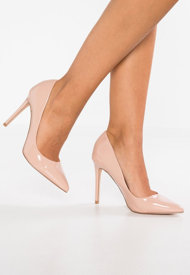 Klassiska pumps - nude
