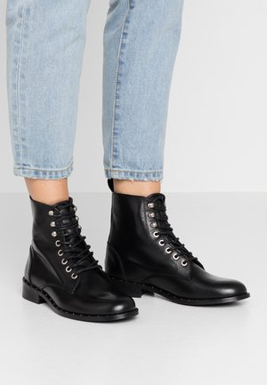 OLIVIA BOOTY - Lace-up ankle boots - black
