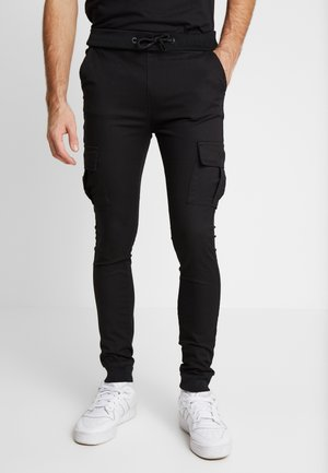 BRANDO  - Cargo trousers - black