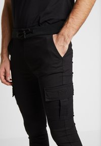 FAKTOR - BRANDO  - Cargo trousers - black - 3