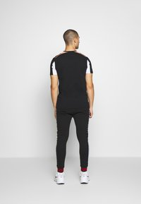 FAKTOR - STITULA - Tracksuit bottoms - black - 2