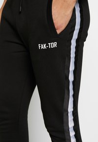 FAKTOR - STITULA - Tracksuit bottoms - black - 5
