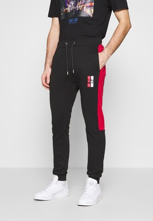 MALLOR - Tracksuit bottoms - black