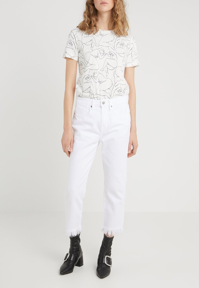 Frame Denim - STEVIE CROP MISCRO SHREDDED RAW - Jeans relaxed fit - blanc