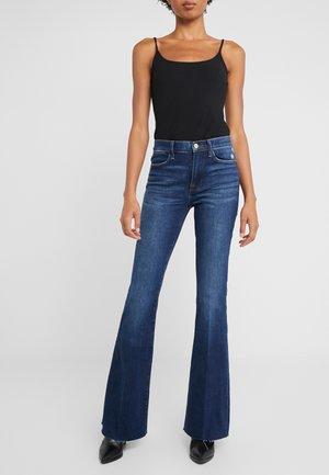 HIGH FLARE RAW EDGE - Flared jeans - blue denim