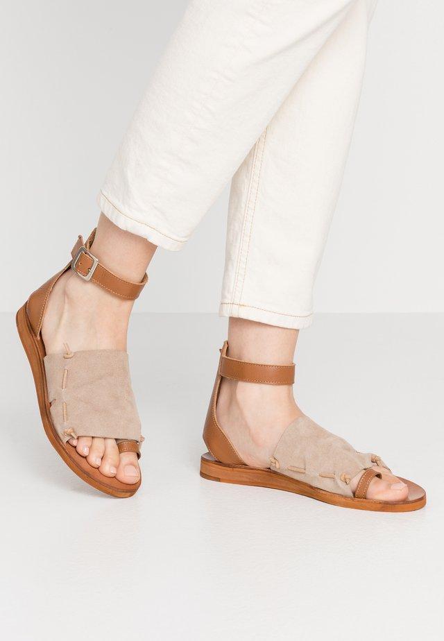 CAROLINA  - T-bar sandals - taupe