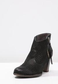 Felmini - OMEGA - Boots à talons - black - 2