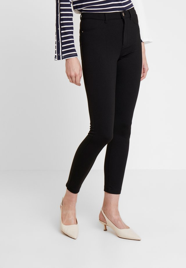 CIRCULAR - Leggings - Trousers - black