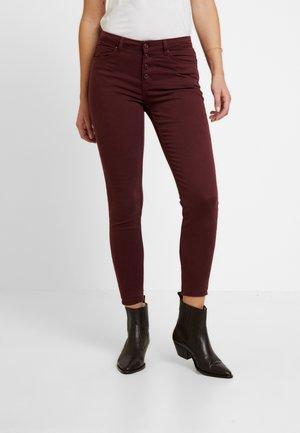 SARGA - Trousers - reds